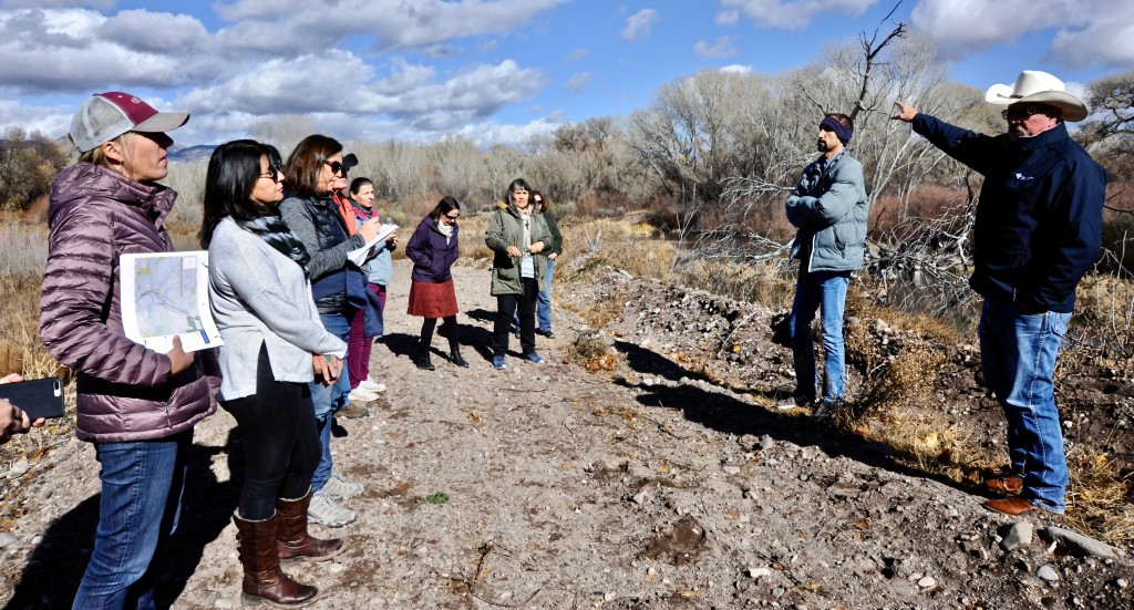 "(Daily Press File Photo by Geoffrey Plant) Members of the New Mexico Interstate Stream Commission, ISC staff, and Gila Conservation Coalition Executive Director Allyson Siwik listen to Dave Ogilvie of the Gila Basin Irrigation Commission and ISC Gila Basin Manager Ali Effati describe how irrigators currently use temporary ""push-up"" dams to divert water into ditches. Commissioners visited a dozen or so proposed and existing projects during a two-day field trip to southwestern New Mexico last November."