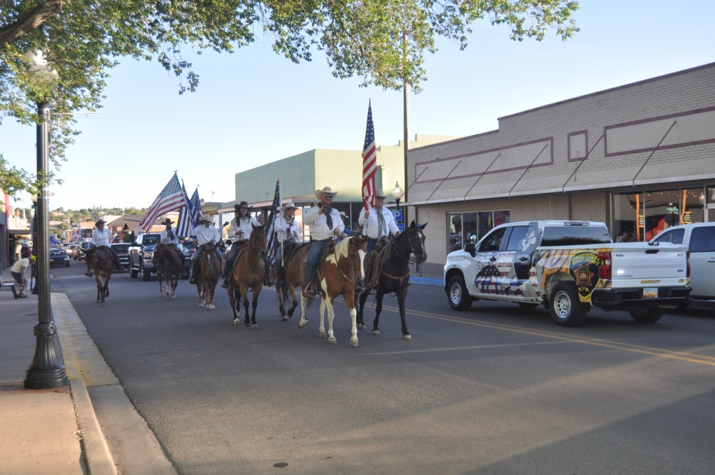 (Photo by Aaron Rogers for the Daily Press) Horseback members of Cowboys for Trump lead a parade of cars, including Grant County Sheriff's Office vehicles, down Bullard in support of law enforcement Friday evening, following a rally in Gough Park.