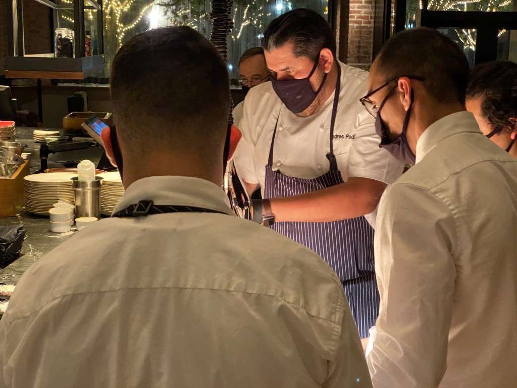 (Press Staff Photos) Plaza Hotel Executive Chef Andres Padilla prepares a plate during Ambar restaurant's first dinner service June 17.