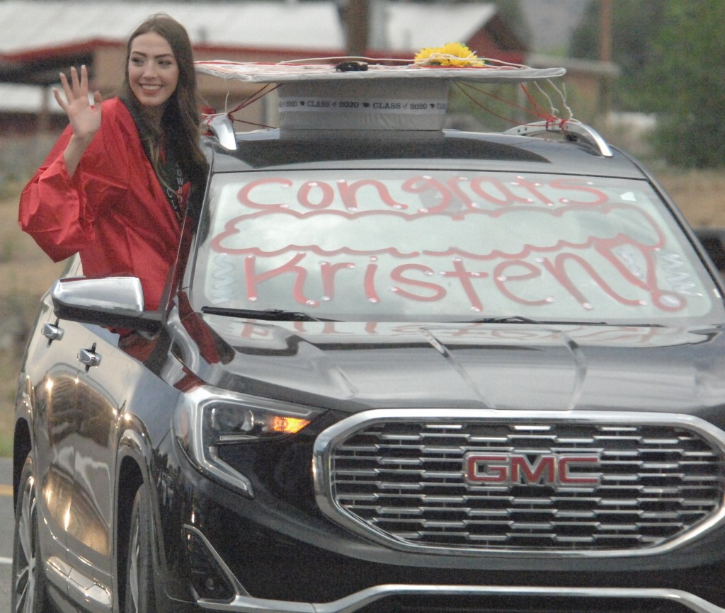 """(Press Staff Photo by Dean Thompson) Kristen Hom waves to onlookers during the Cliff graduation parade held on U.S. 180 just before commencement in the Cliff School courtyard Friday evening. Cliff held a """"drive-in"""" ceremony and had 14 graduates in the 2020 class."""